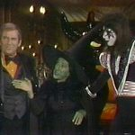 Ace Frehley with Paul Lynde and Margaret Hamilton from the special.